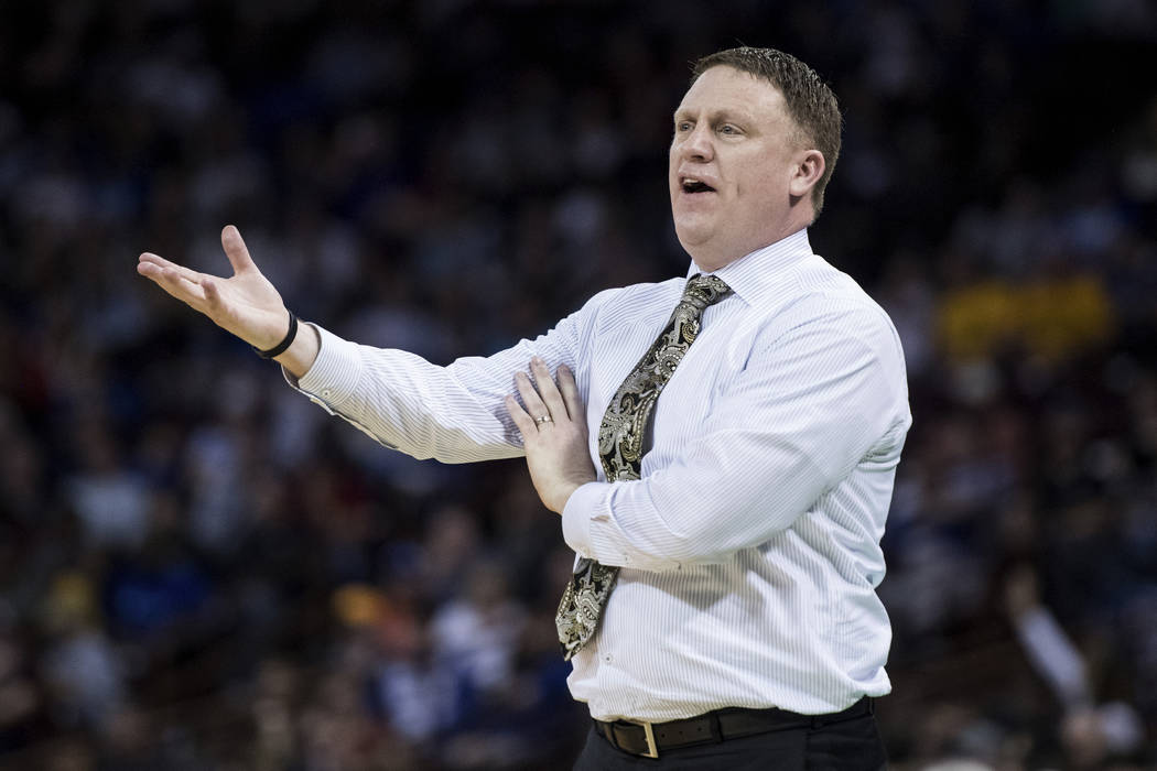VCU coach Mike Rhoades talks with an official during the first half of a first-round game against Central Florida in the NCAA men's college basketball tournament Friday, March 22, 2019, in Columbi ...