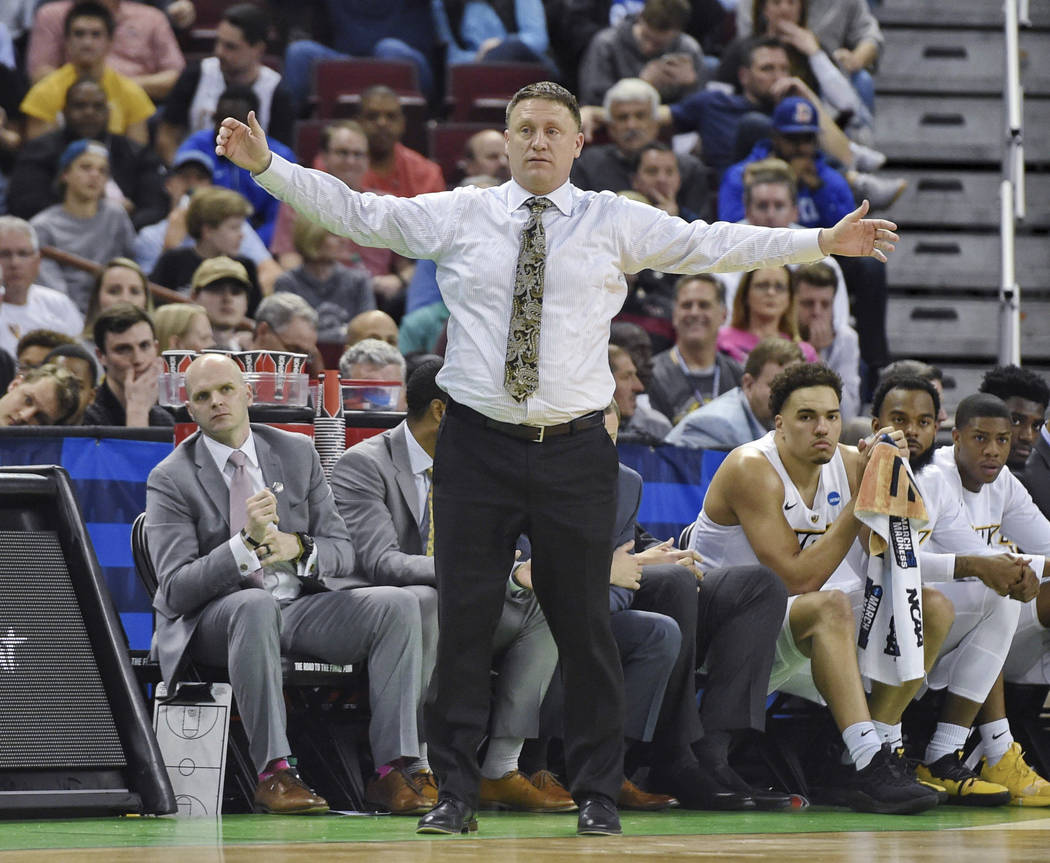VCU coach Mike Rhoades watches during the first half of the team's game against Central Florida in the first round of the NCAA men's college basketball tournament Friday, March 22, 2019, in ...