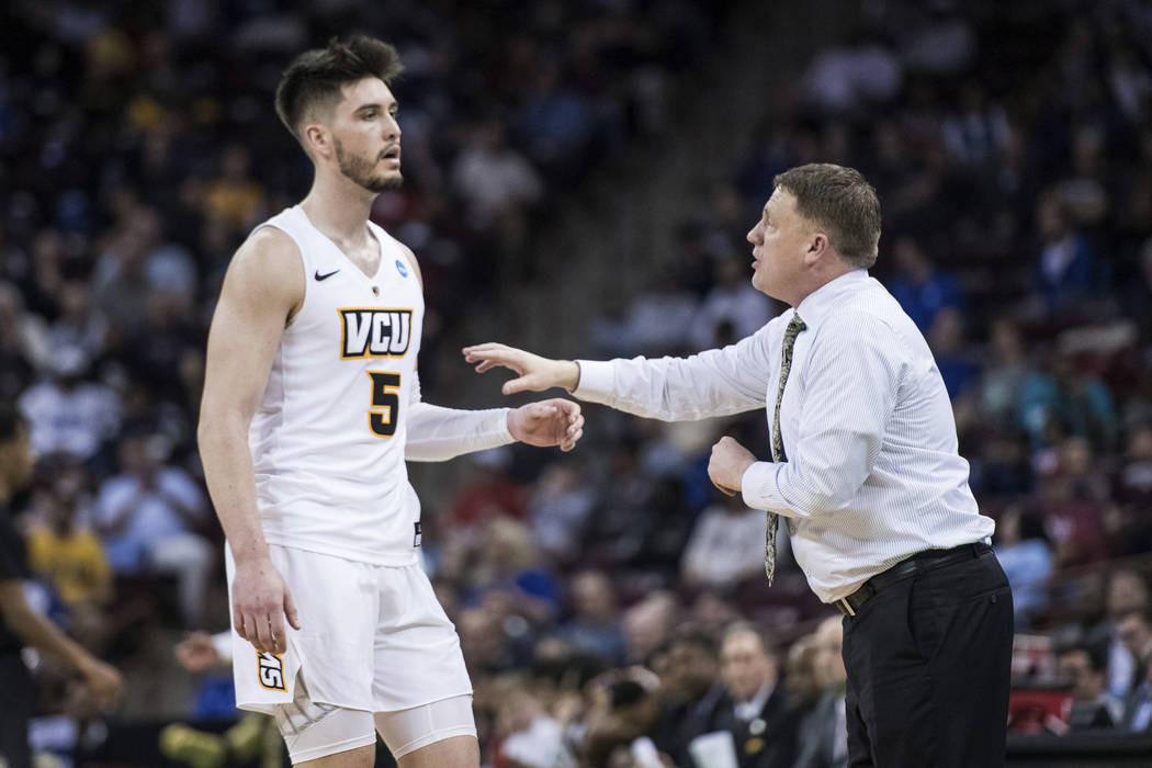 VCU head coach Mike Rhoades, right, talks with forward Sean Mobley (5) during the first half of a first-round game in the NCAA men's college basketball tournament Friday, March 22, 2019, in Columb ...