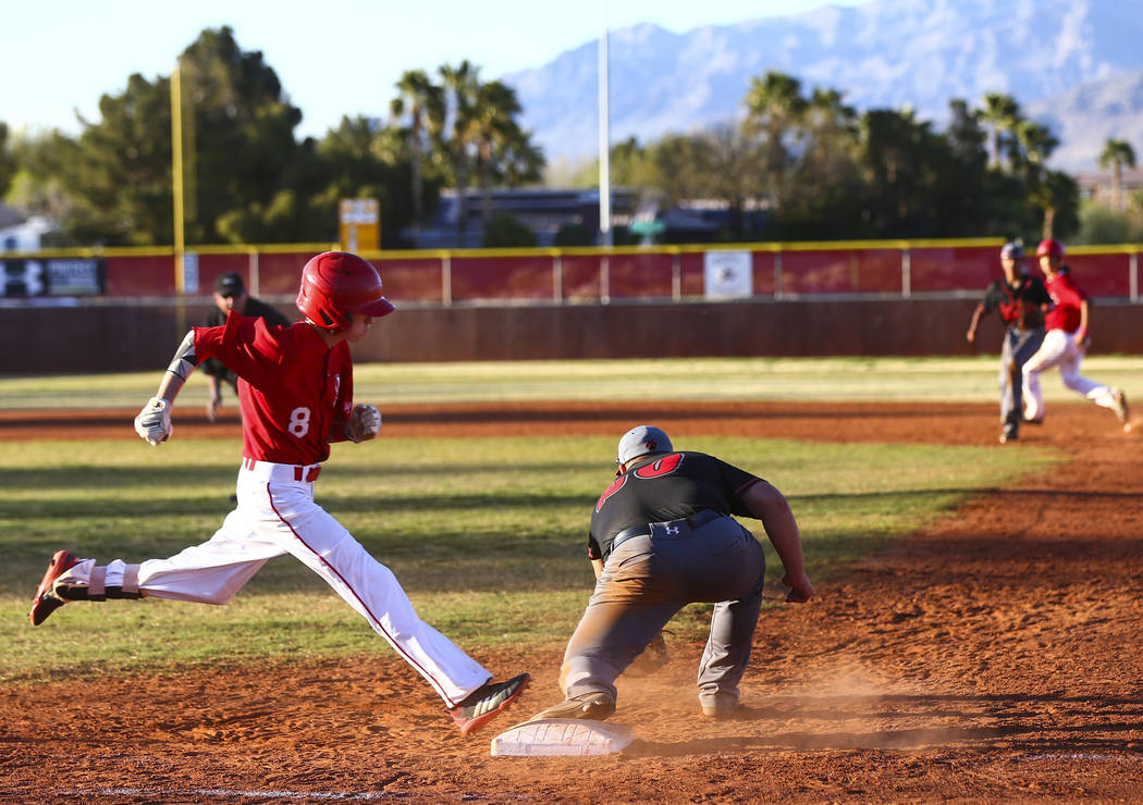 Arbor View's Payton Brooks (8) gets tagged out by Las Vegas' Trevor Johnson during a baseball g ...