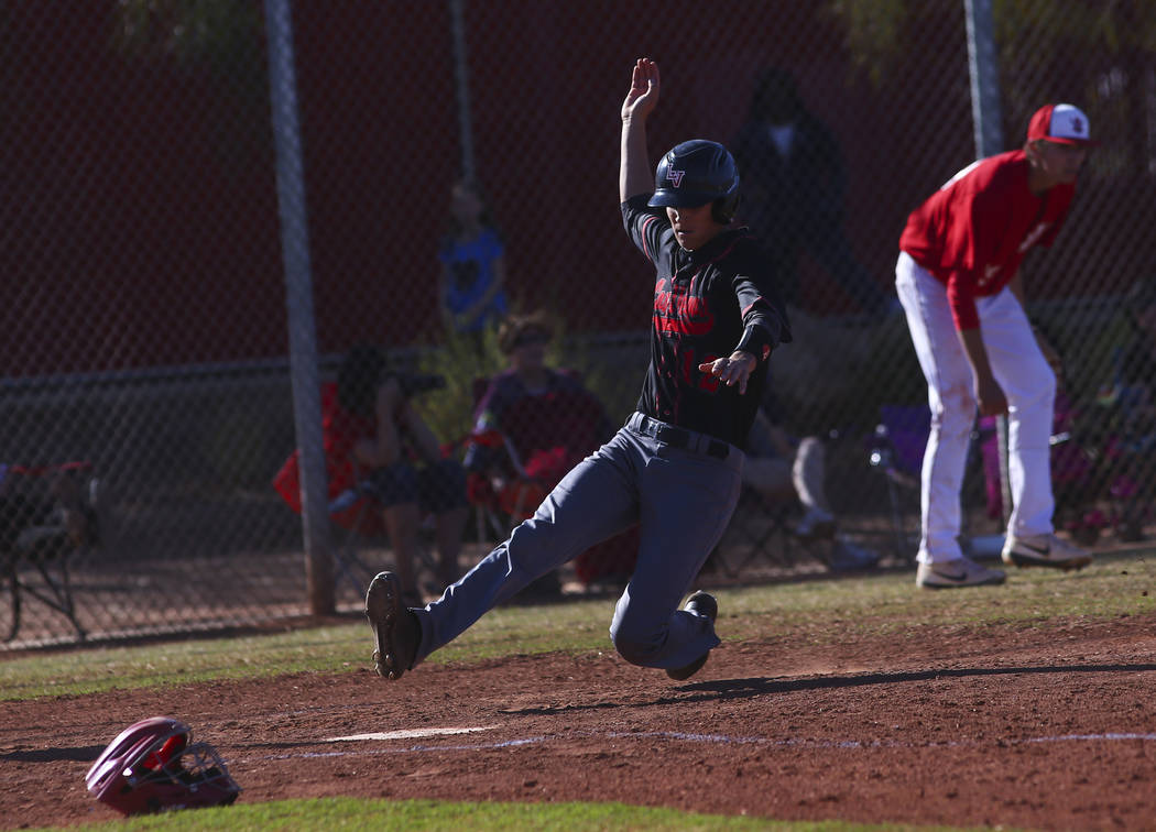 Las Vegas' Nathan Freimuth (12) scores a run against Arbor View during a baseball game at Arbor ...