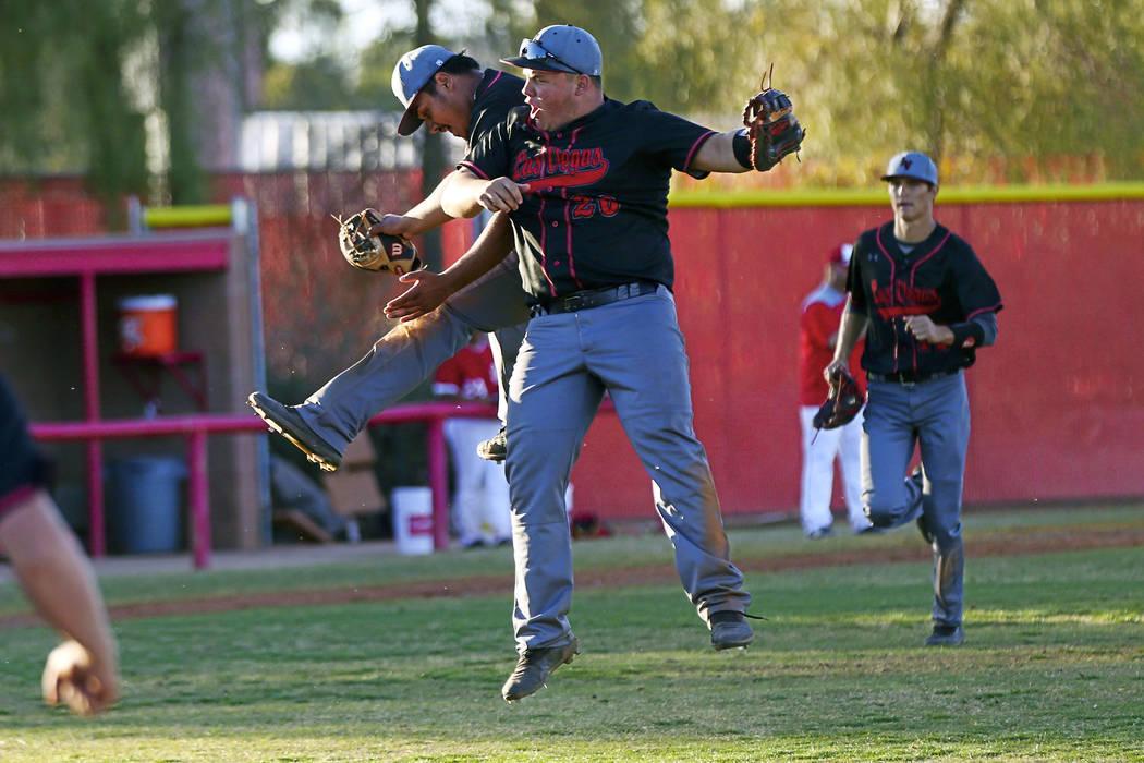 Las Vegas' Daniel Jimenez, left, and Trevor Johnson (20) celebrate the team's win over Arbor Vi ...