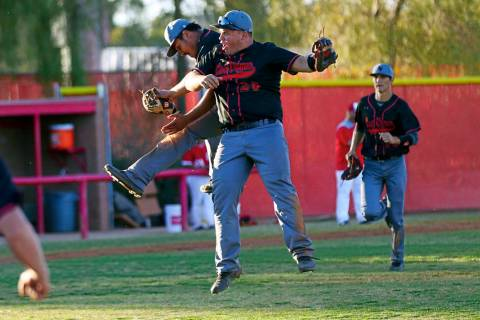 Las Vegas' Daniel Jimenez, left, and Trevor Johnson (20) celebrate the team's win over Arbor Vi ...