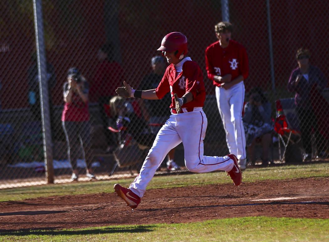 Arbor View's Nicholas Cornman (2) scores a run against Las Vegas during a baseball game at Arbo ...