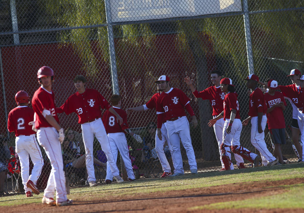 Arbor View players celebrate a pair of runs against Las Vegas during a baseball game at Arbor V ...