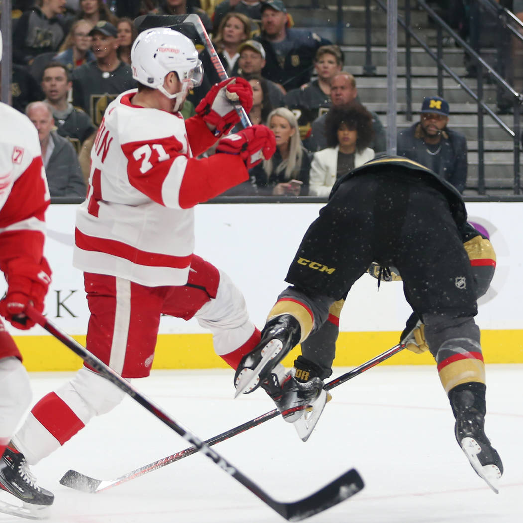 Vegas Golden Knights center Paul Stastny (26) is pushed by Detroit Red Wings center Dylan Larkin (71) during the first period of an NHL hockey game at T-Mobile Arena in Las Vegas, Saturday, March ...