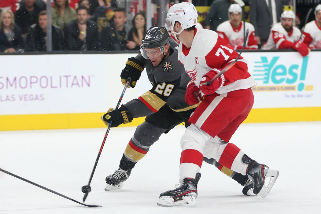 Vegas Golden Knights center Paul Stastny (26) shoots the puck for a miss under pressure from Detroit Red Wings center Dylan Larkin (71) during the first period of an NHL hockey game at T-Mobile Ar ...