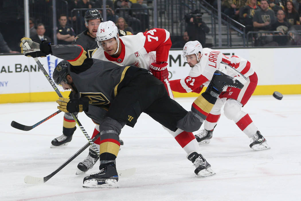 Vegas Golden Knights right wing Alex Tuch (89) loses the puck against Detroit Red Wings defenseman Madison Bowey (74) during the first period of an NHL hockey game at T-Mobile Arena in Las Vegas, ...