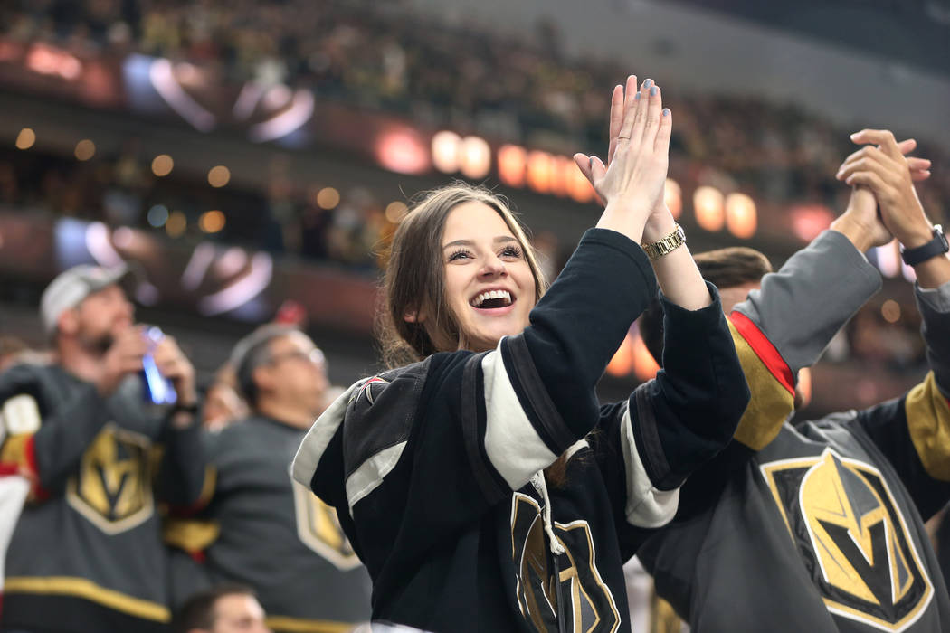 A fan celebrates a goal by Vegas Golden Knights center Cody Eakin (21) during the second period of an NHL hockey game at T-Mobile Arena in Las Vegas, Saturday, March 23, 2019. Erik Verduzco Las Ve ...