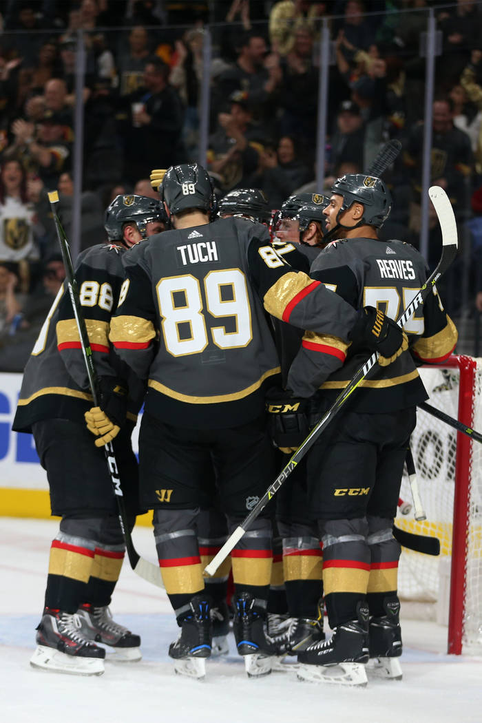 Vegas Golden Knights celebrate a score by center Cody Eakin (21) during the second period of an NHL hockey game at T-Mobile Arena in Las Vegas, Saturday, March 23, 2019. Erik Verduzco Las Vegas Re ...