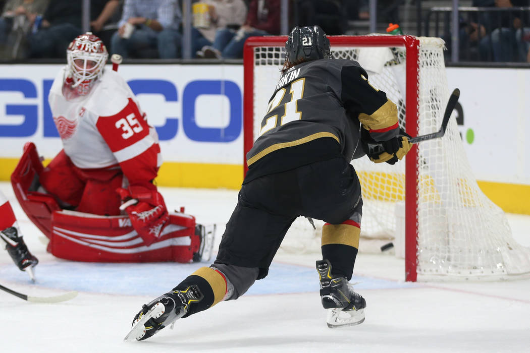 Vegas Golden Knights center Cody Eakin (21) shoots for a score against the Detroit Red Wings during the second period of an NHL hockey game at T-Mobile Arena in Las Vegas, Saturday, March 23, 2019 ...