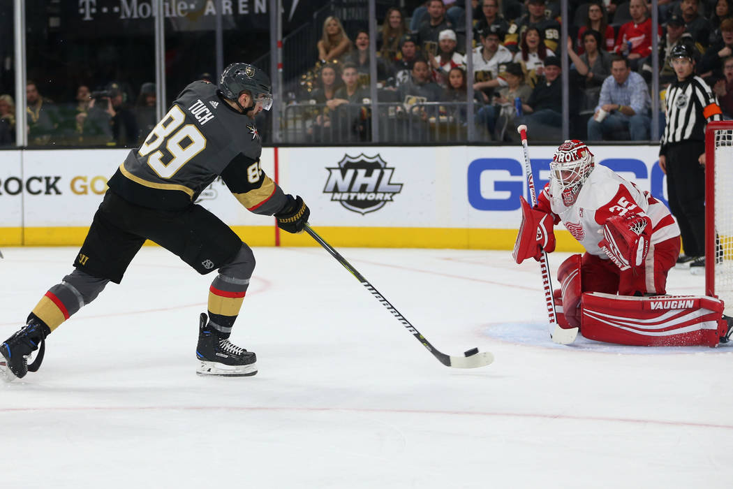 Vegas Golden Knights right wing Alex Tuch (89) takes a shot for a miss against Detroit Red Wings goaltender Jimmy Howard (35) during the second period of an NHL hockey game at T-Mobile Arena in La ...