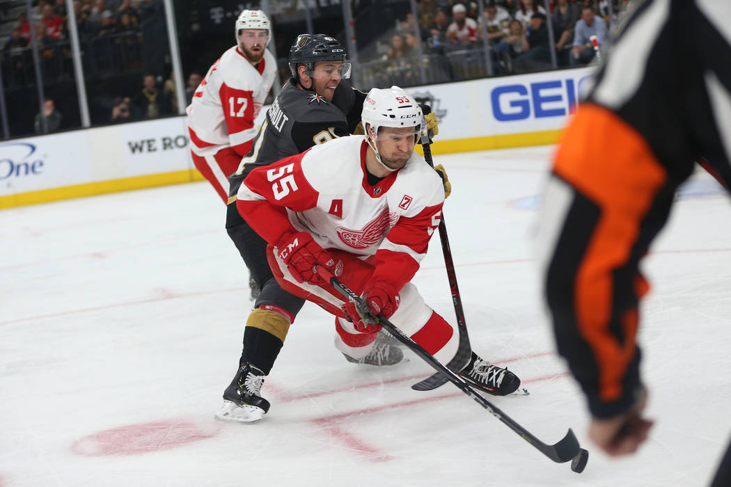Vegas Golden Knights center Jonathan Marchessault (81) goes for a loose puck against Detroit Red Wings defenseman Niklas Kronwall (55) during the second period of an NHL hockey game at T-Mobile A ...