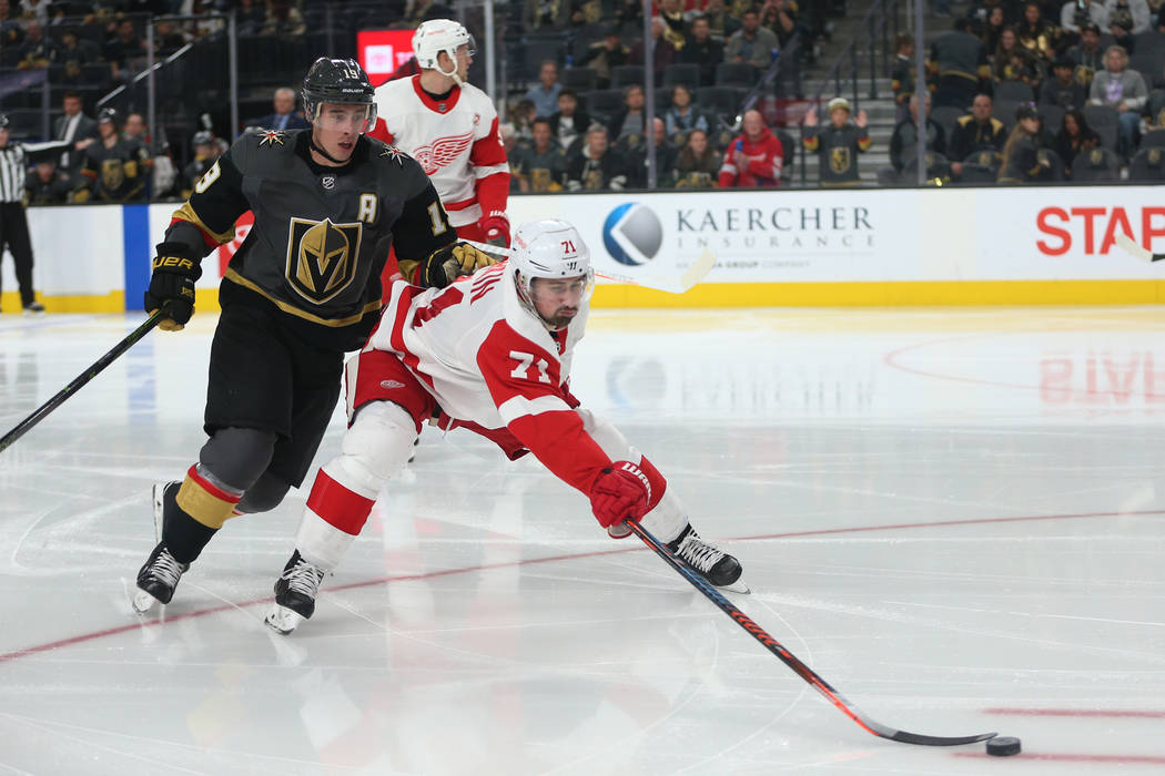 Vegas Golden Knights right wing Reilly Smith (19) goes for the puck against Detroit Red Wings center Dylan Larkin (71) during the second period of an NHL hockey game at T-Mobile Arena in Las Vegas ...