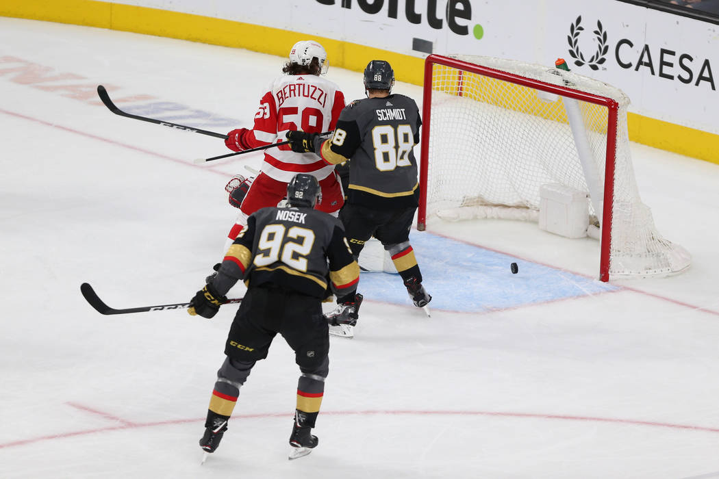 Vegas Golden Knights defenseman Nate Schmidt (88) and left wing Tomas Nosek (92), covering Detroit Red Wings left wing Tyler Bertuzzi (59), watch as the puck misses their goal during the third per ...