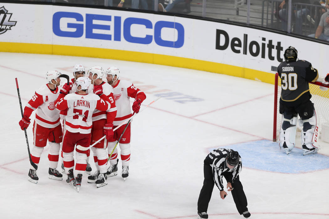 Detroit Red Wings celebrate a score by right wing Anthony Mantha (39) during the third period of an NHL hockey game at T-Mobile Arena in Las Vegas, Saturday, March 23, 2019. Erik Verduzco Las Vega ...
