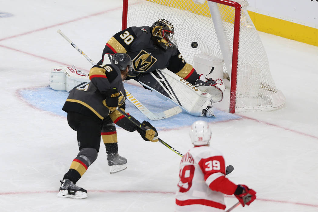 Detroit Red Wings right wing Anthony Mantha (39) shoots for a score against Vegas Golden Knights goaltender Malcolm Subban (30) and defenseman Jon Merrill (15) during the third period of an NHL ho ...