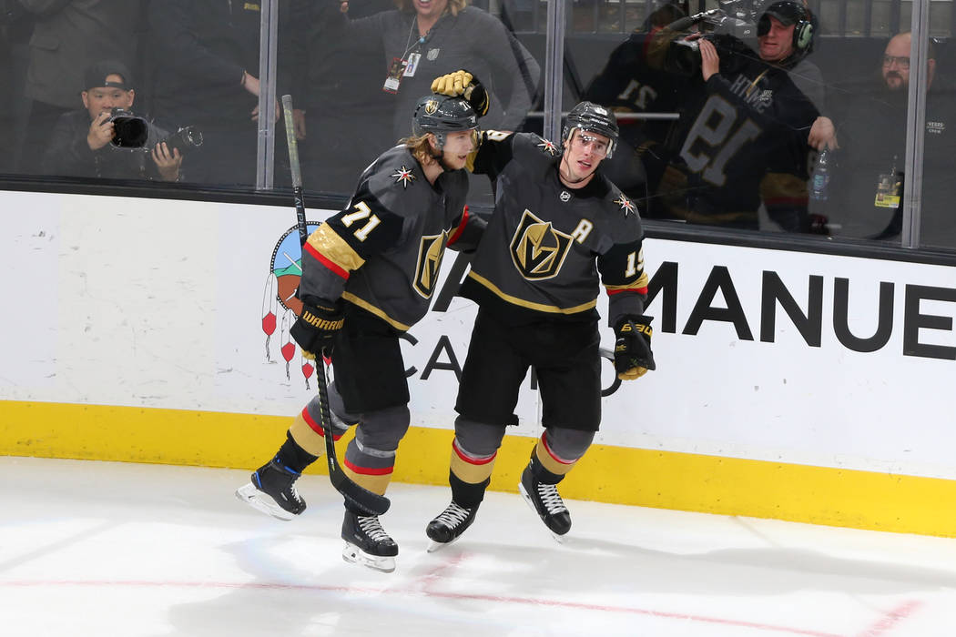 Vegas Golden Knights right wing Reilly Smith (19) celebrates his score with center William Karlsson (71) during the third period of an NHL hockey game at T-Mobile Arena in Las Vegas, Saturday, Mar ...