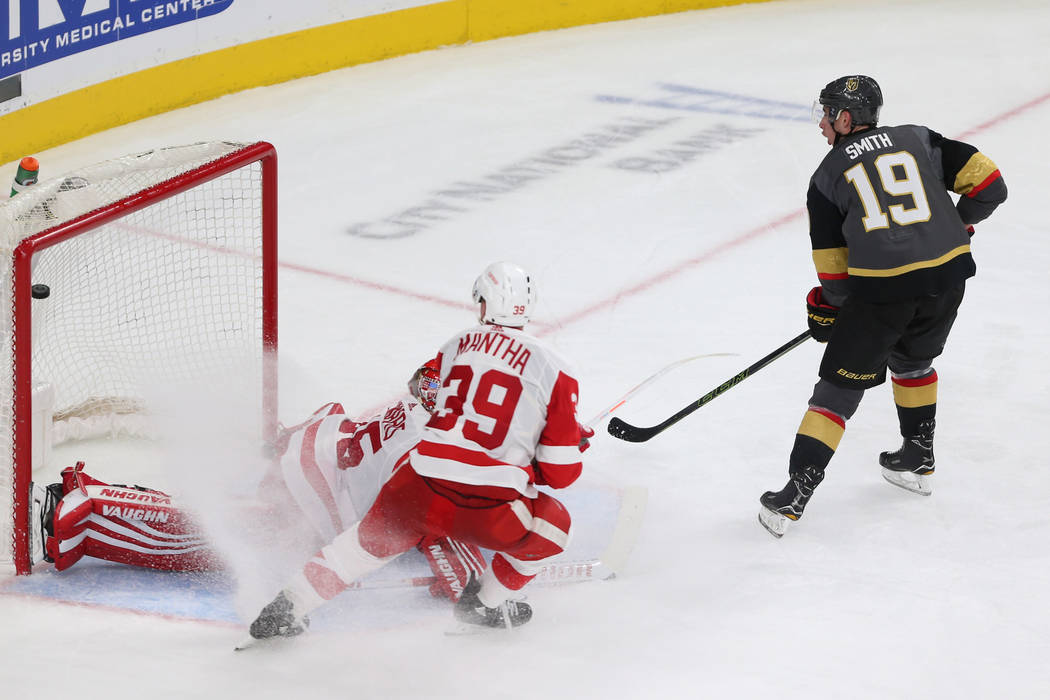 Vegas Golden Knights right wing Reilly Smith (19) shoots for a score against Detroit Red Wings goaltender Jimmy Howard (35) and right wing Anthony Mantha (39) during the third period of an NHL hoc ...