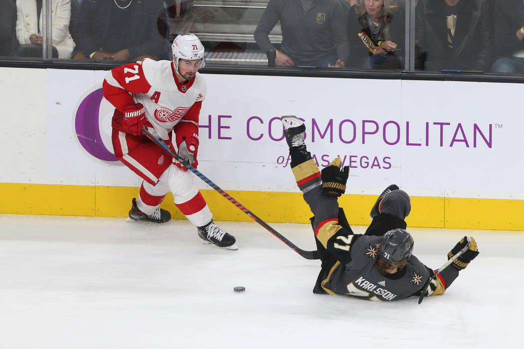 Detroit Red Wings center Dylan Larkin (71) trips Vegas Golden Knights center William Karlsson (71) during the third period of an NHL hockey game at T-Mobile Arena in Las Vegas, Saturday, March 23, ...