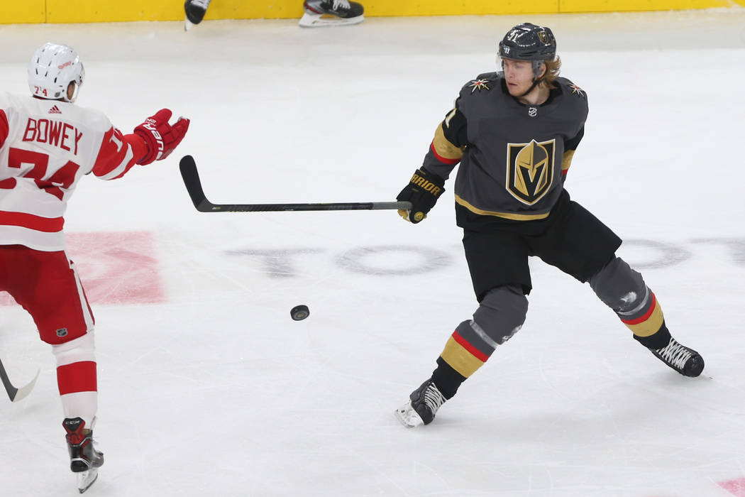 Vegas Golden Knights center William Karlsson (71) goes for the puck against Detroit Red Wings defenseman Madison Bowey (74) during the third period of an NHL hockey game at T-Mobile Arena in Las V ...