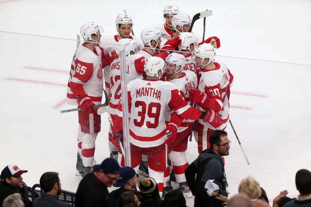 Detroit Red Wings right wing Anthony Mantha (39) celebrates his winning score with his team during overtime of an NHL hockey game at T-Mobile Arena in Las Vegas, Saturday, March 23, 2019. Detroit ...