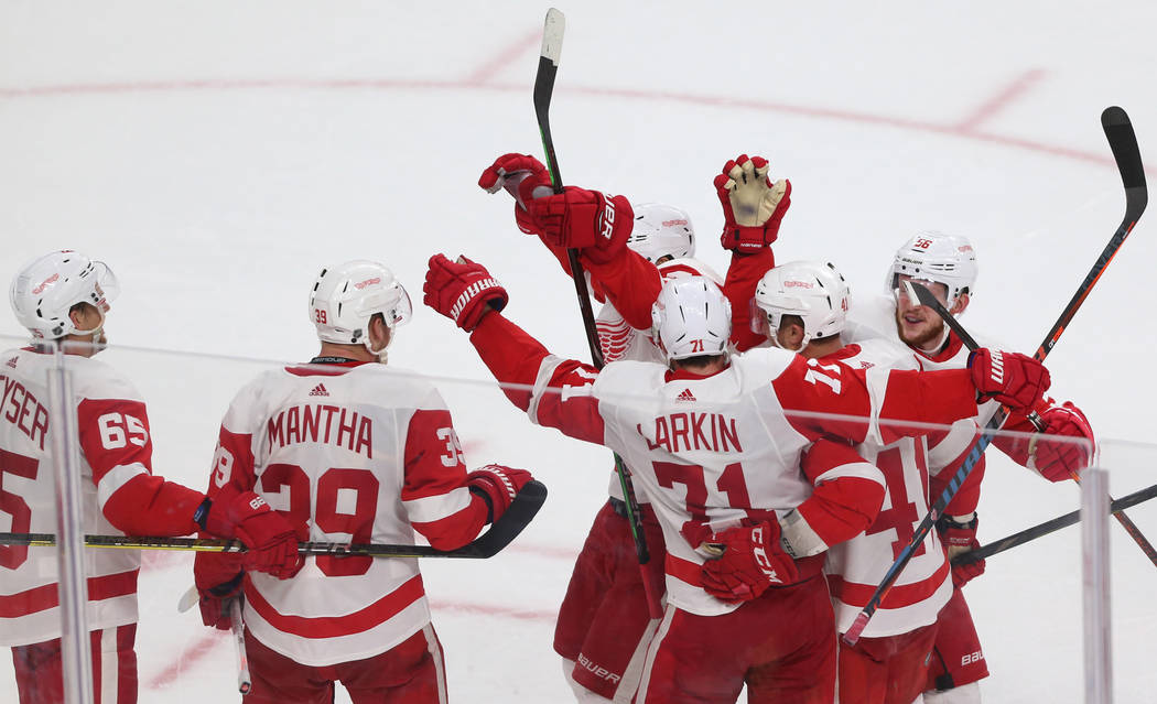 Detroit Red Wings right wing Anthony Mantha (39) celebrates the winning goal with the assist by center Dylan Larkin (71) during overtime of an NHL hockey game at T-Mobile Arena in Las Vegas, Satur ...