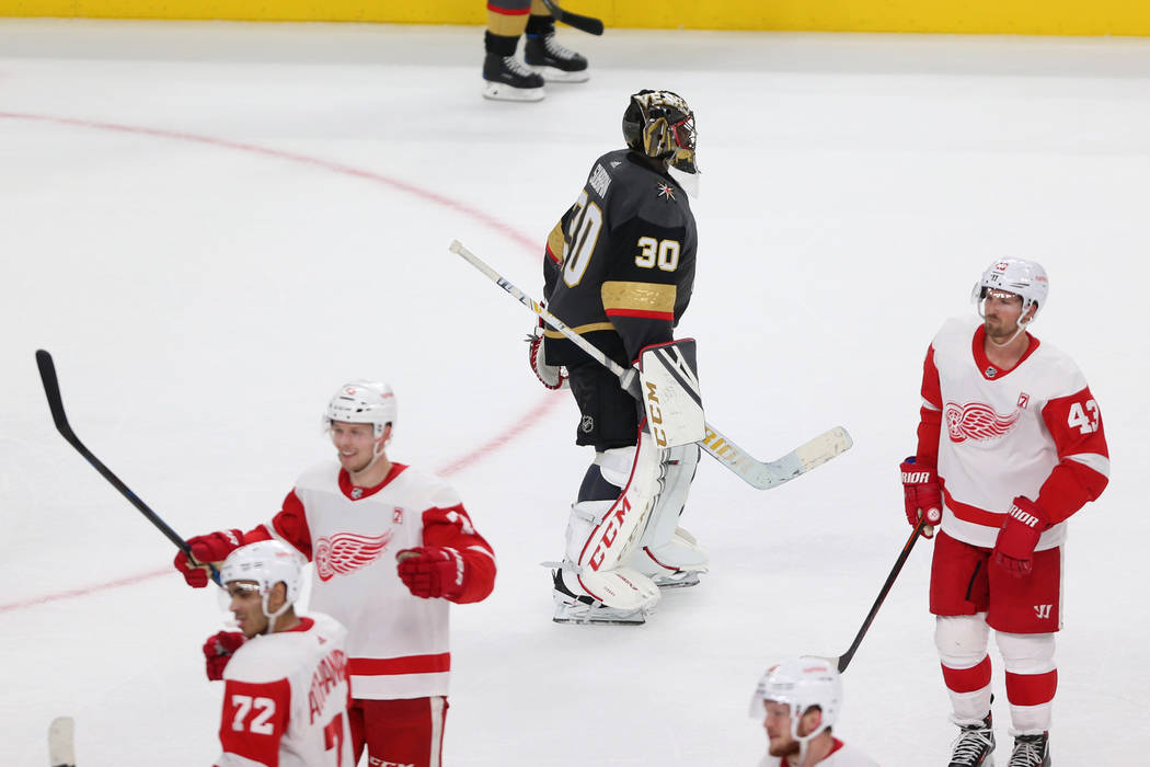 Vegas Golden Knights goaltender Malcolm Subban (30) leaves the ice as Detroit Red Wings celebrates their winning goal during overtime of an NHL hockey game at T-Mobile Arena in Las Vegas, Saturday ...