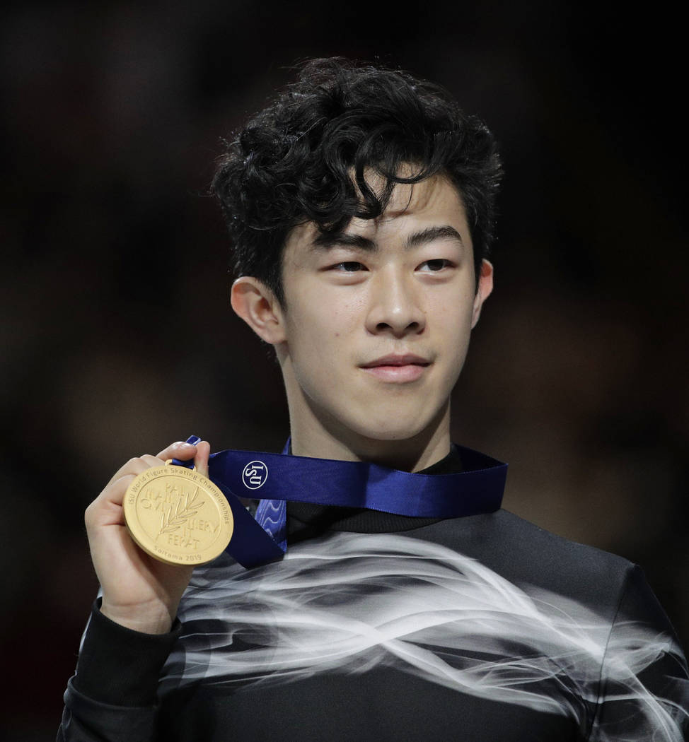Nathan Chen from the U.S. stands on the podium with the gold medal for the men's free skating routine during the ISU World Figure Skating Championships at Saitama Super Arena in Saitama, north of ...