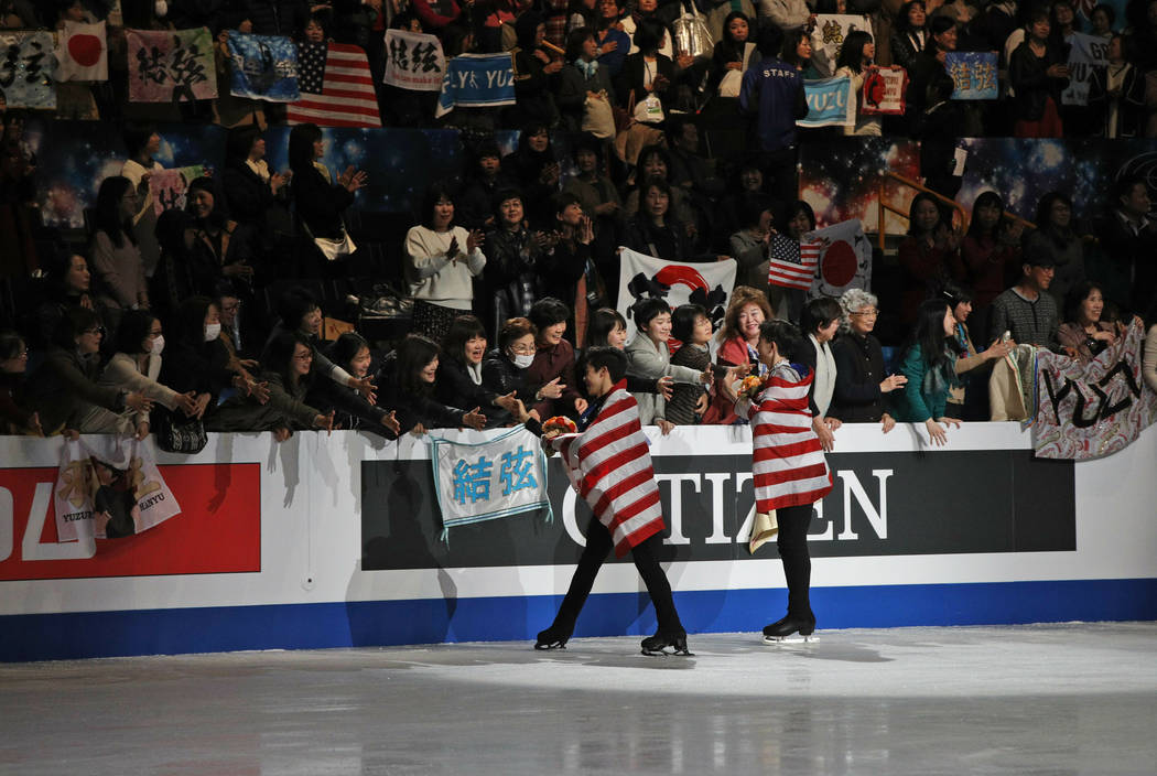 Nathan Chen from the U.S., left, and compatriot Vincent Zhou acknowledge the crowd after winning the gold and bronze medals respectively for the men's free skating routine during the ISU World Fig ...