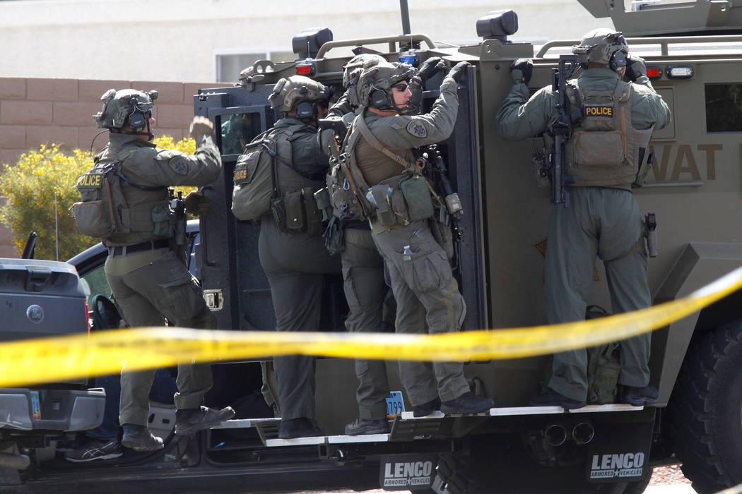 Metropolitan Police Department SWAT units are visible during a barricade situation near Grand Teton and Durango in the northwest area of the Las Vegas valley, Saturday, March 23, 2019. (Chitose Su ...
