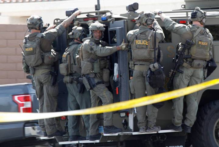 A SWAT vehicle carries a Metropolitan Police Department SWAT team during a barricade situation near Grand Teton and Durango in the northwest area of the Las Vegas valley, Saturday, March 23, 2019 ...