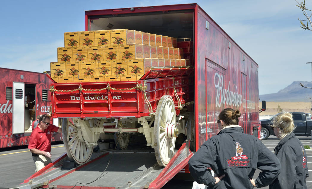 The beer wagon is unloaded from a semi-trailer during a visit by the Budweiser Clydesdales to the Smith's Marketplace at 9710 W. Skye Canyon Park Drive in Las Vegas on Saturday, March 23, 2 ...