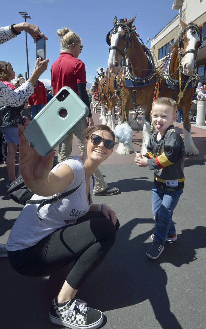 Kristy Pewitt takes a picture with her son Grayson, 3, during a visit by the Budweiser Clydesdales to the Smith's Marketplace at 9710 W. Skye Canyon Park Drive in Las Vegas on Saturday, Mar ...