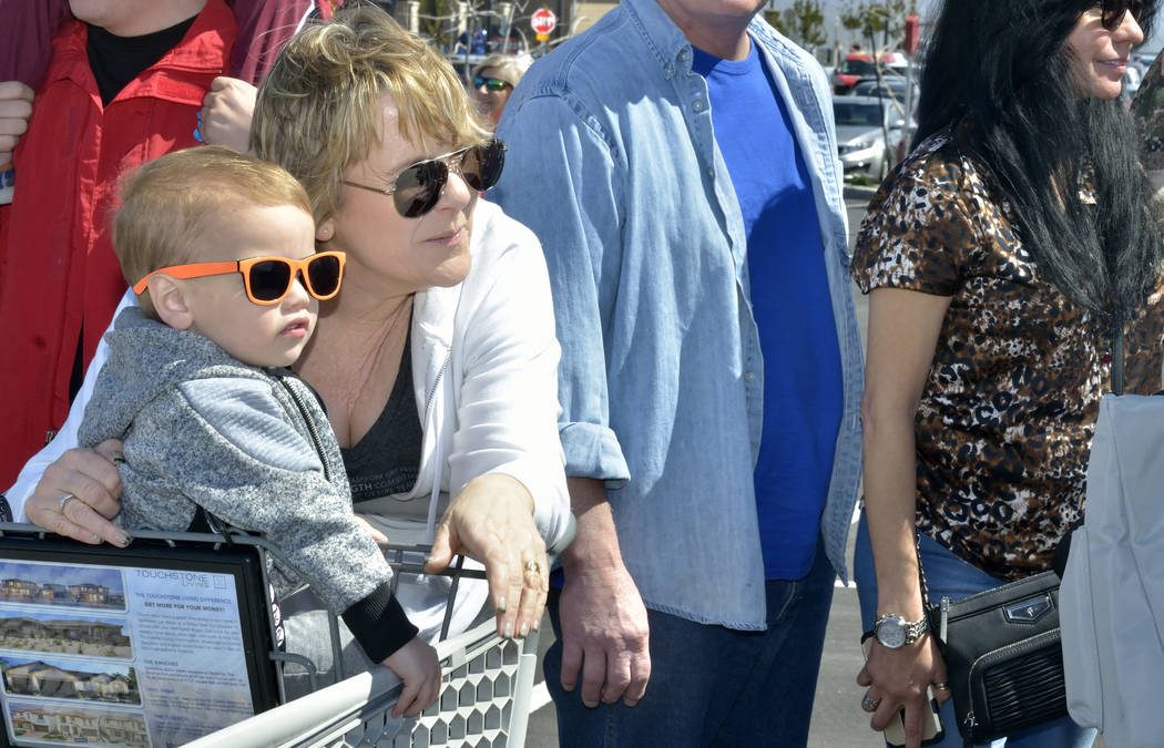 Ellis Hellums, 2, watches with his grandmother Brenda Clendenen during a visit by the Budweiser Clydesdales to the Smith's Marketplace at 9710 W. Skye Canyon Park Drive in Las Vegas on Satu ...