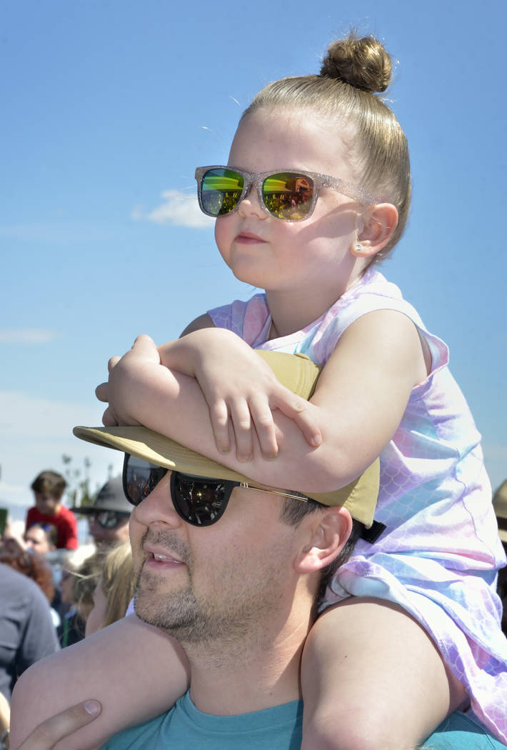Piper Christensen, 5, watches with her father Stewart during a visit by the Budweiser Clydesdales to the Smith's Marketplace at 9710 W. Skye Canyon Park Drive in Las Vegas on Saturday, Marc ...