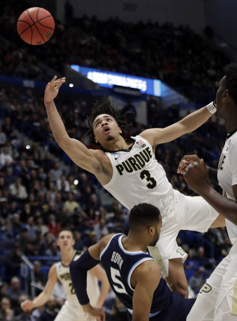 Purdue's Carsen Edwards (3) drives and is fouled by Villanova's Phil Booth (5) during the first half of a second round men's college basketball game in the NCAA Tournament, Saturday, March 23, 201 ...