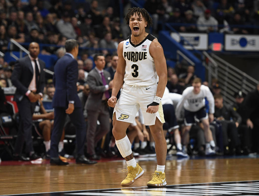 Purdue's Carsen Edwards (3) reacts during the first half of a second-round men's college basketball game against Villanova in the NCAA tournament, Saturday, March 23, 2019, in Hartford, Conn. (AP ...