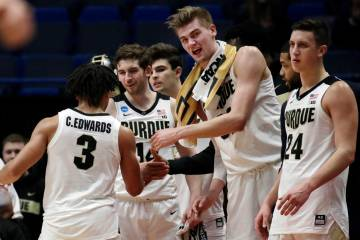 Purdue's Carsen Edwards (3) receives congratulations from Matt Haarms, second from right, and other teammates as he leaves late in the second half of a second-round men's college basketball game a ...
