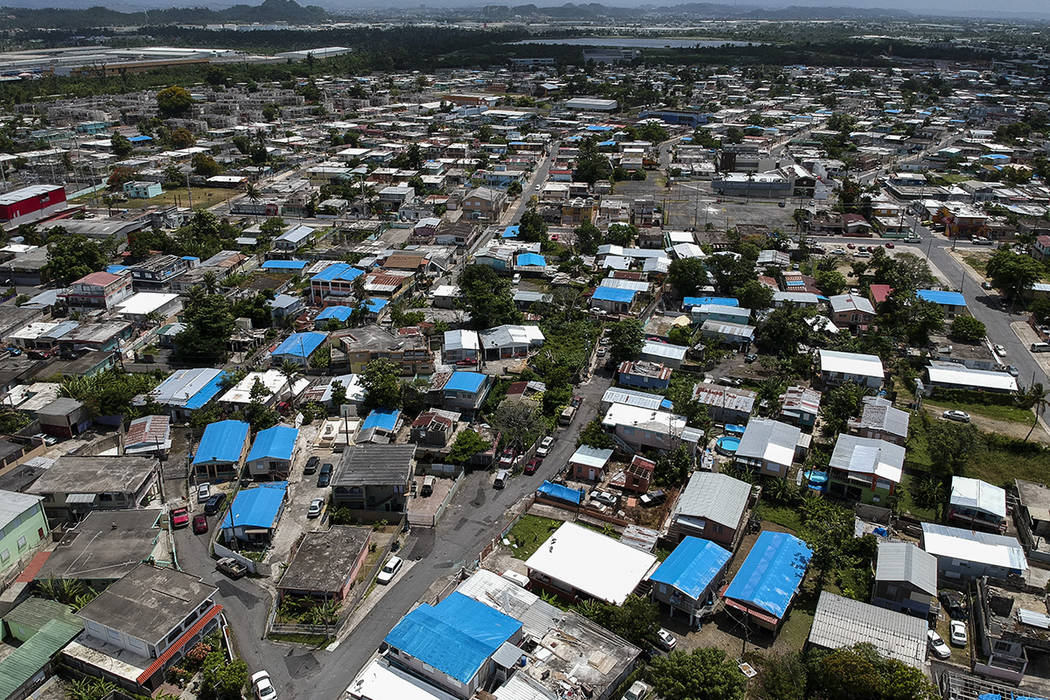 This June 18, 2018, file photo shows an aerial view of the Amelia neighborhood in the municipality of Catano, east of San Juan, Puerto Rico. A long-delayed disaster aid bill that's a top politic ...