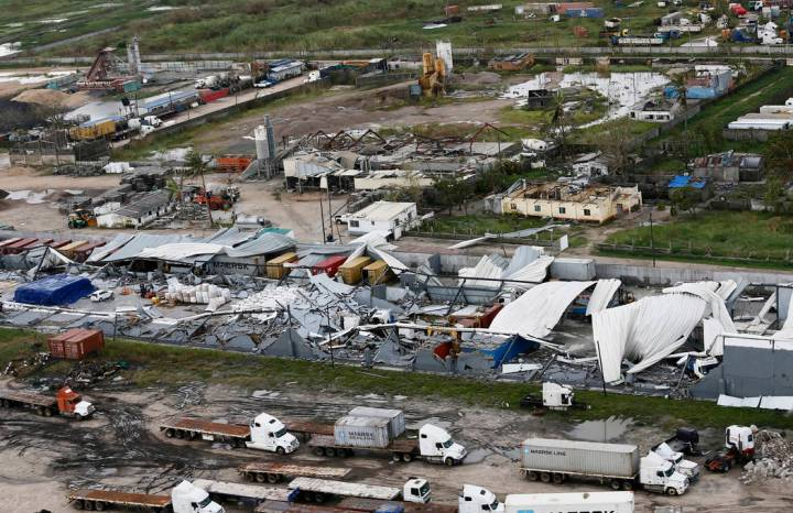 An aerial photo shows a damaged factory following the devastating Tropical Cyclone Idai in Beira, Mozambique, Saturday, March 23, 2019. A second week has begun with efforts to find and help some t ...