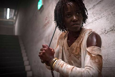 "This image released by Universal Pictures shows Lupita Nyong'o in a scene from ""Us,"" written, produced and directed by Jordan Peele. (Claudette Barius/Universal Pictures via AP)"