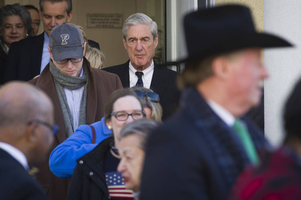 Special Counsel Robert Mueller exits St. John's Episcopal Church after attending services, across from the White House, in Washington, Sunday, March 24, 2019. Mueller closed his long and contentio ...