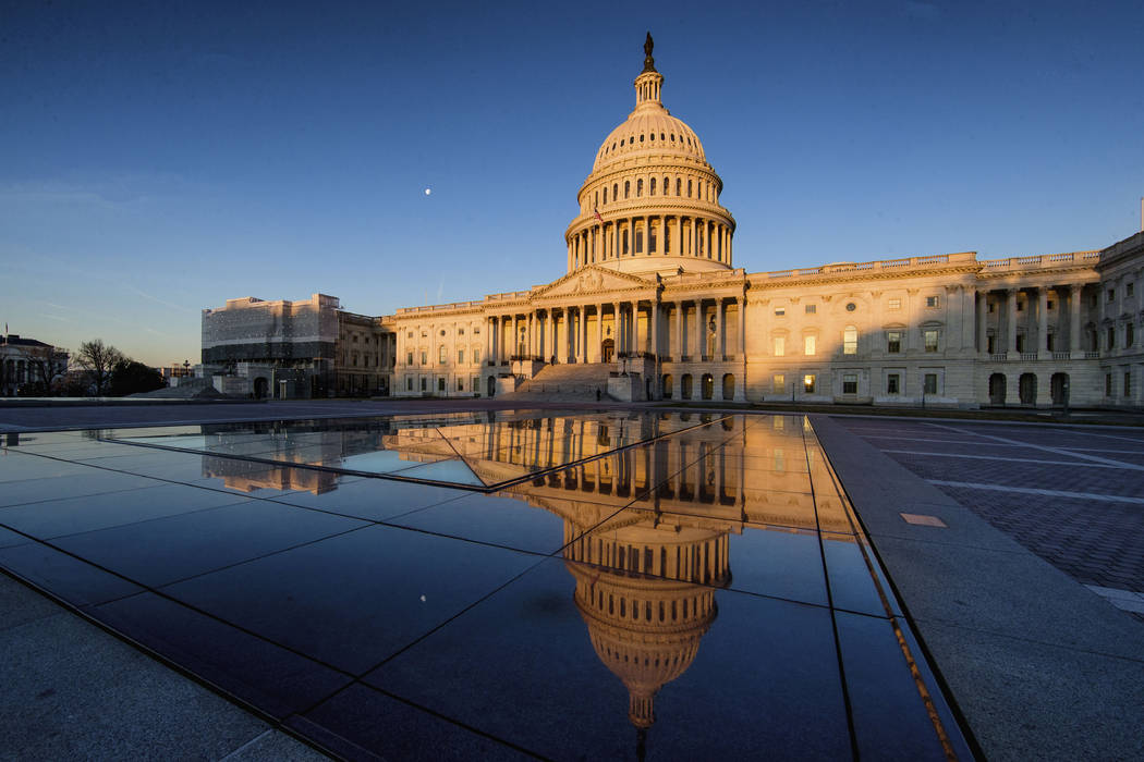 The U.S Capitol is seen at sunrise, Sunday, March 24, 2019, in Washington. The special counsel's report on how the Russians tried to influence the 2016 presidential election and any involvement w ...
