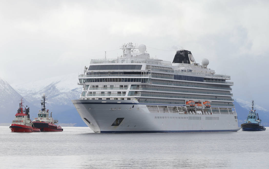 The cruise ship Viking Sky arrives at port off Molde, Norway, Sunday March 24, 2019, after the problems in heavy seas off Norway's western coast. Rescue helicopters took more than 475 passengers f ...