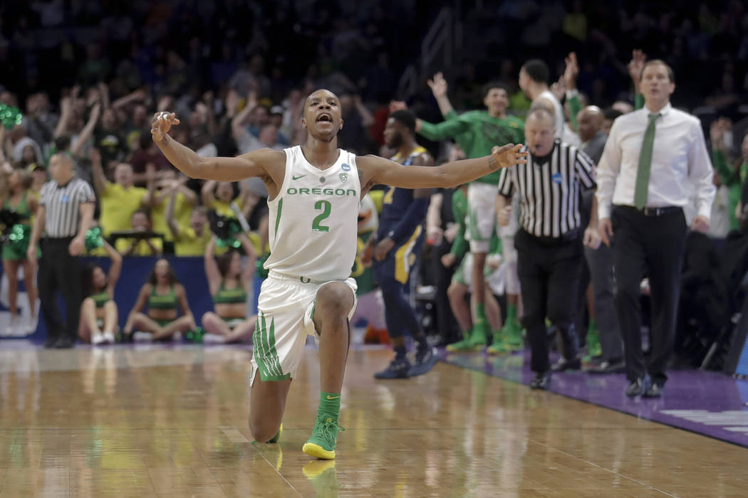 Oregon forward Louis King celebrates after scoring against UC Irvine during the second half of a second-round game in the NCAA men's college basketball tournament Sunday, March 24, 2019, in San Jo ...