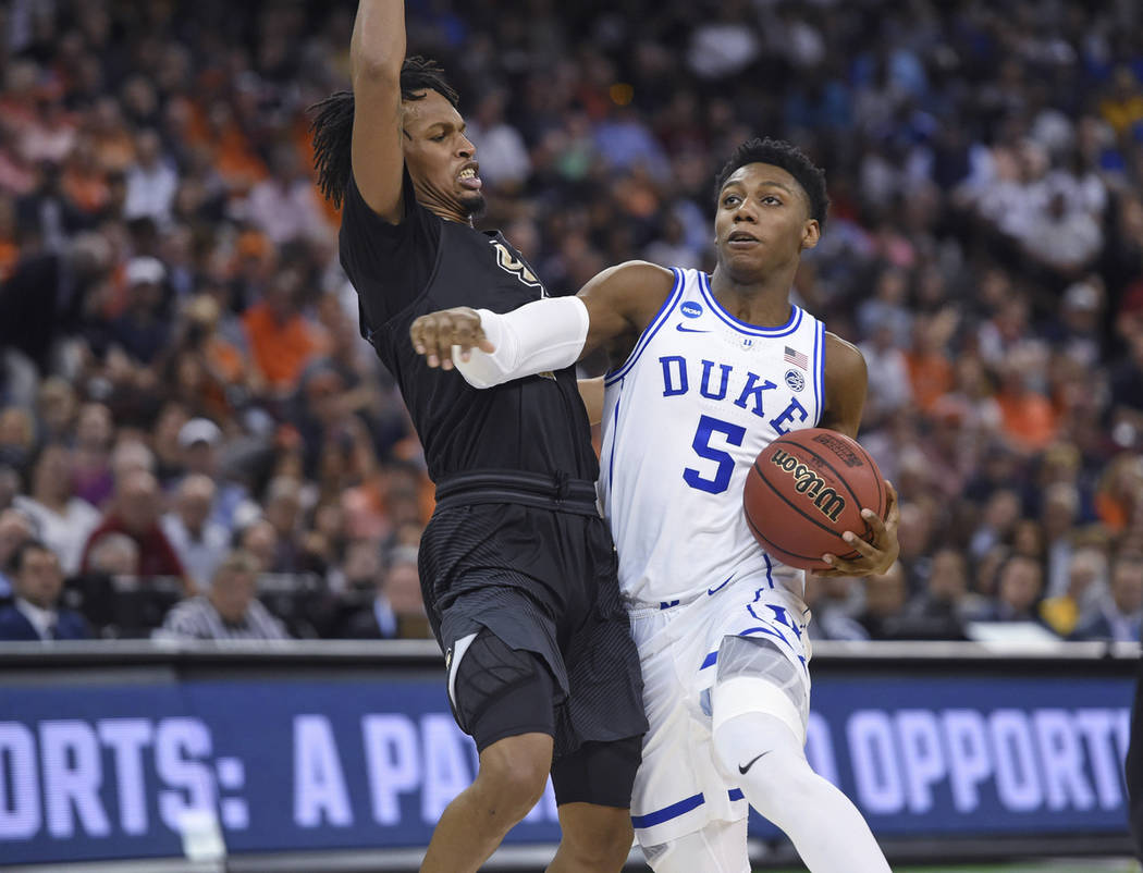 Duke's RJ Barrett (5) drives while defended by Central Florida's Terrell Allen during the second half of a second-round men's college basketball game in the NCAA Tournament in Columbia, S.C., Sund ...