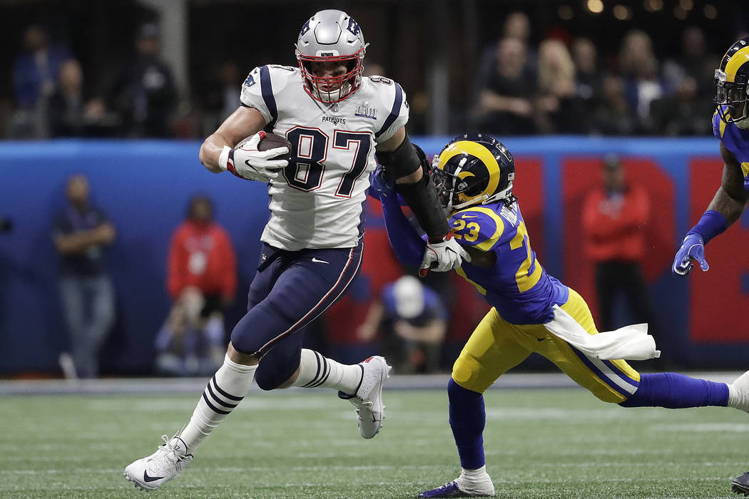 In this Feb. 3, 2019, file photo, New England Patriots' Rob Gronkowski (87) runs against Los Angeles Rams' Nickell Robey-Coleman (23) during the first half of the NFL Super Bowl 53 football game i ...