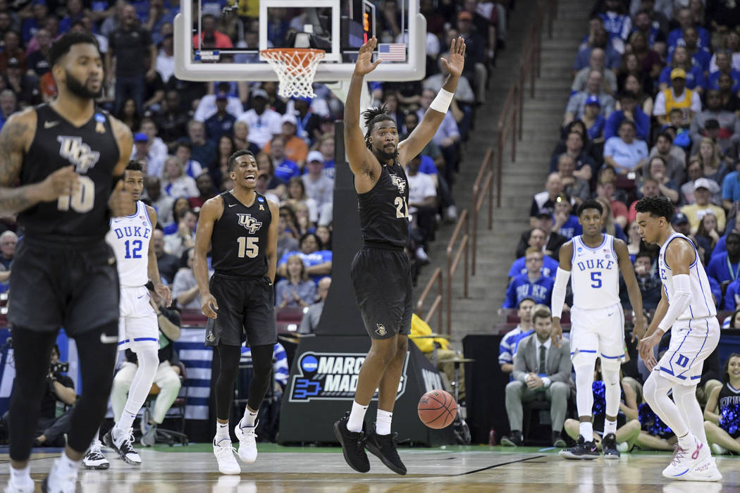 Central Florida forward Chad Brown (21) celebrates after a dunk against Duke during the first half of a second-round game in the NCAA men's college basketball tournament Sunday, March 24, 2019, in ...
