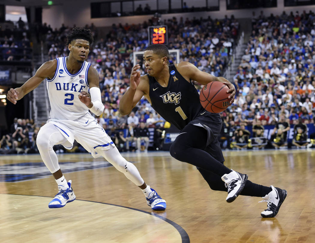 Central Florida's BJ Taylor (1) drives down the baseline while defended by Duke's Cam Reddish (2) during the first half of a first round men's college basketball game in the NCAA Tournament in Col ...